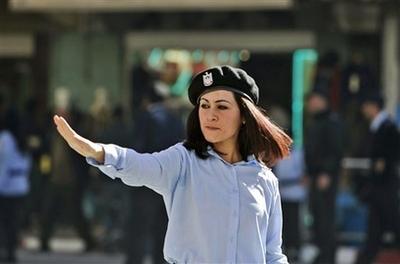 capt1015ad1d791340cd871eb1437190d7d8mideast_israel_palestinians_policewomen_jrl129.jpg